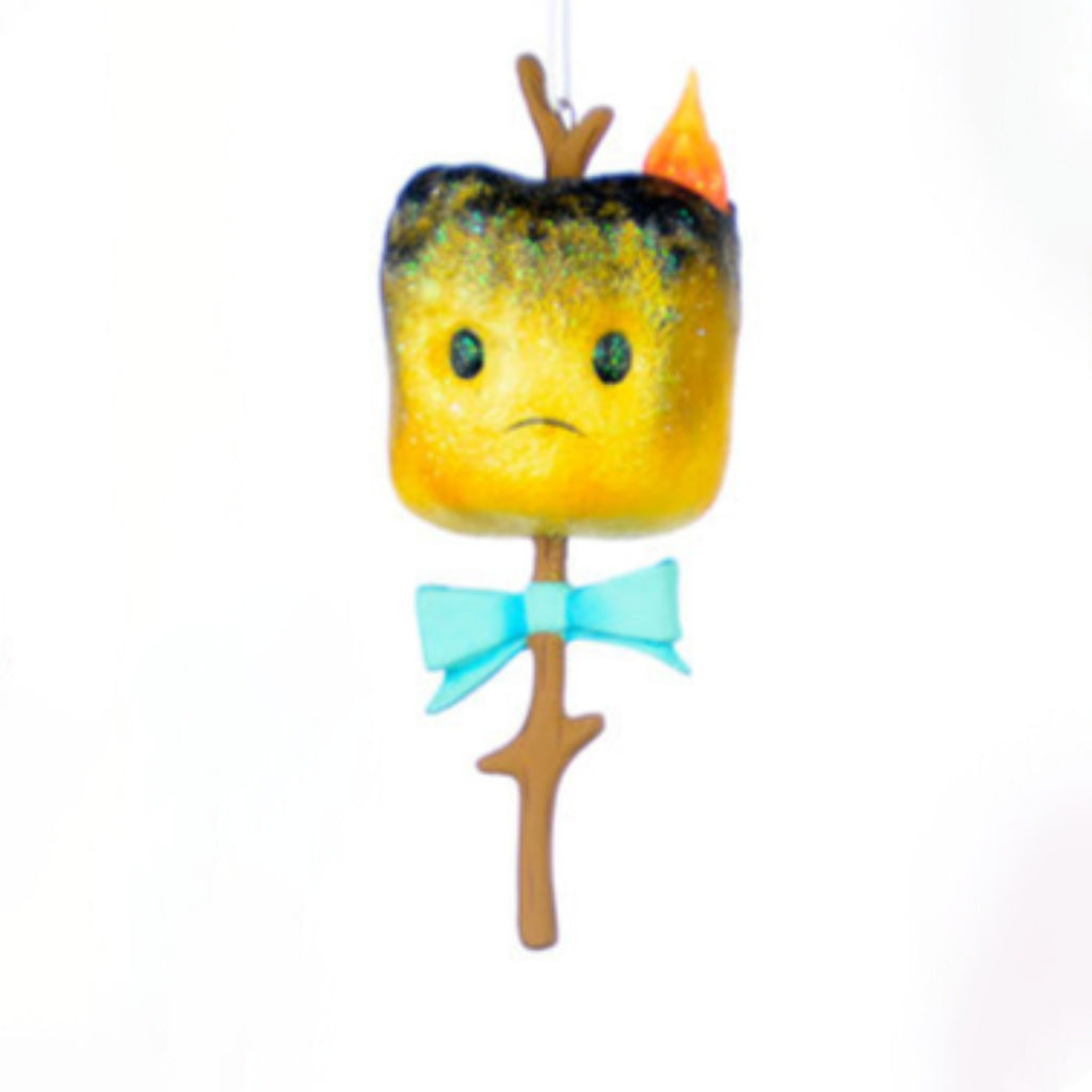 burnt marshmallow on branch with a frowning face wearing a blue bow tie