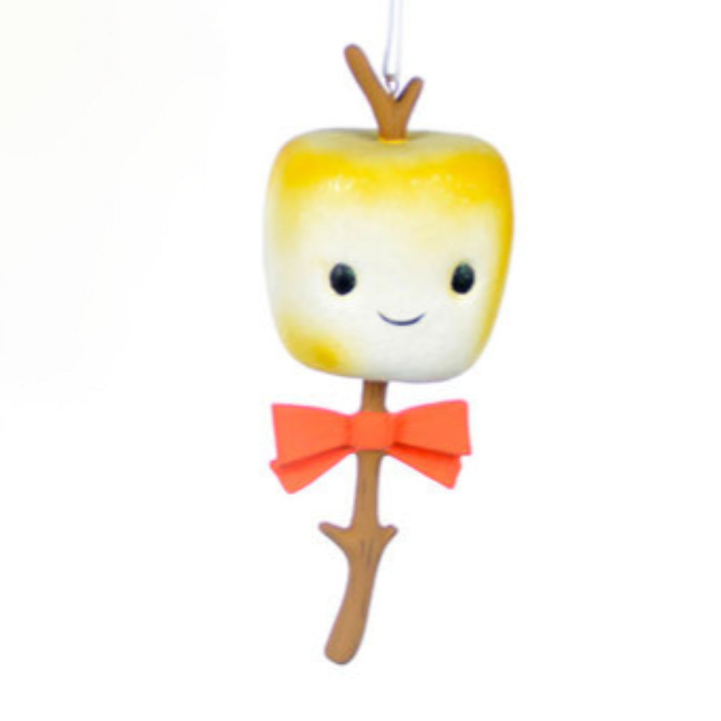 toasted marshmallow on a branch with smiling face wearing a red bow tie