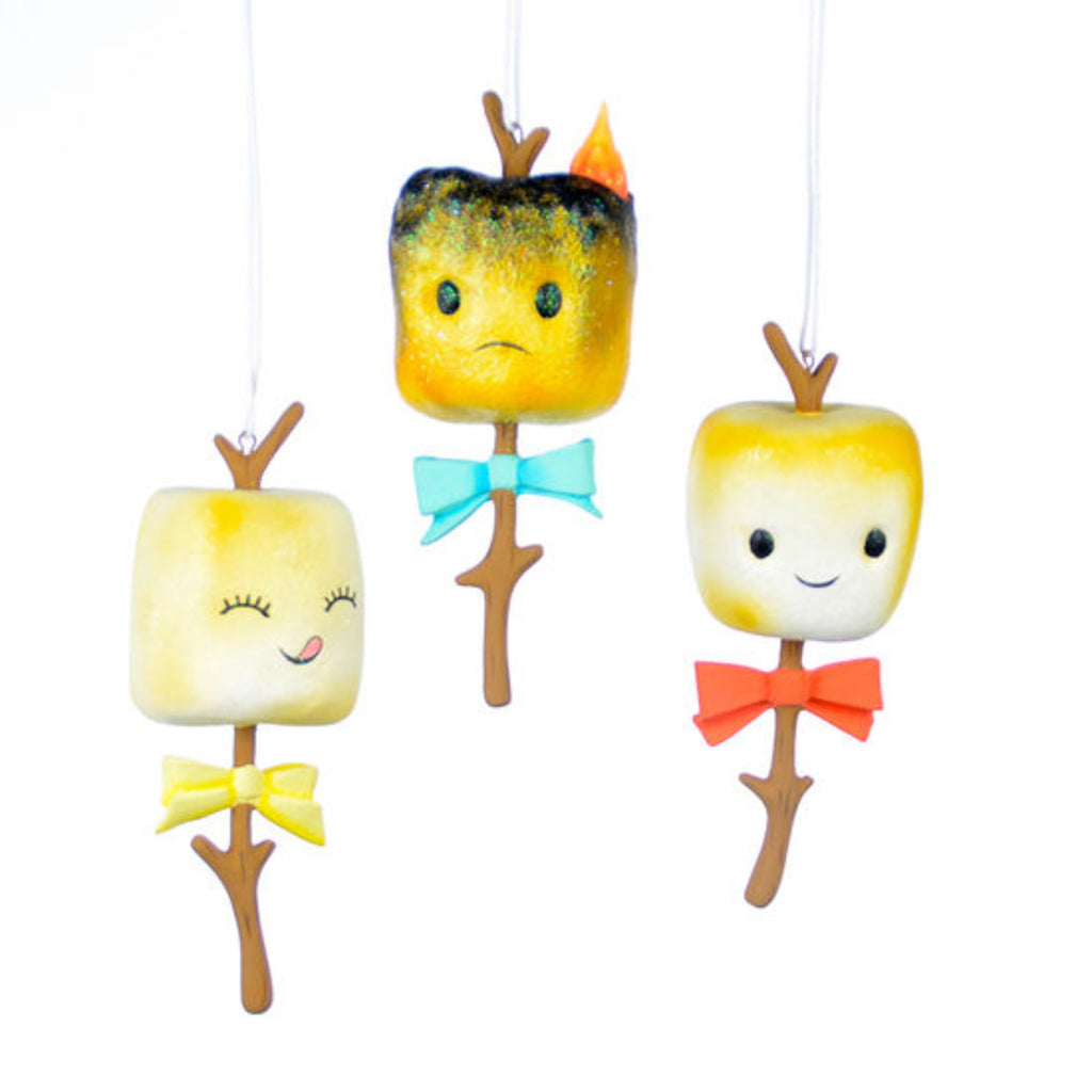 resin ornaments of marshmallows on sticks with faces and bows