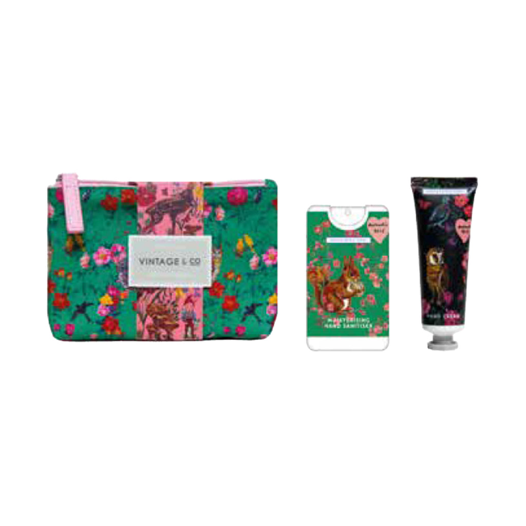 mcardle co nathalie lete illustrated hand cream and hand sanitizer gift set in green and pink cosmetic pouch