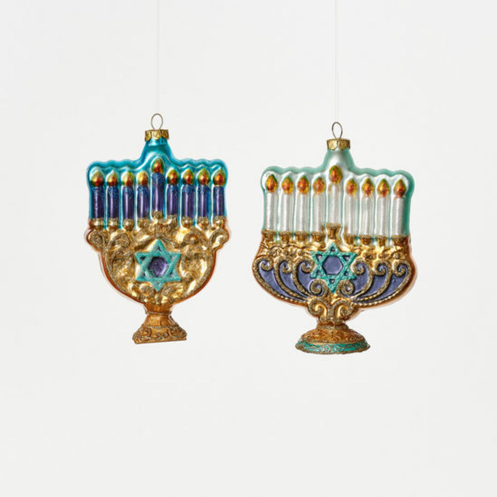 glass ornament with gold menorah, staar of david, and white or blue candles