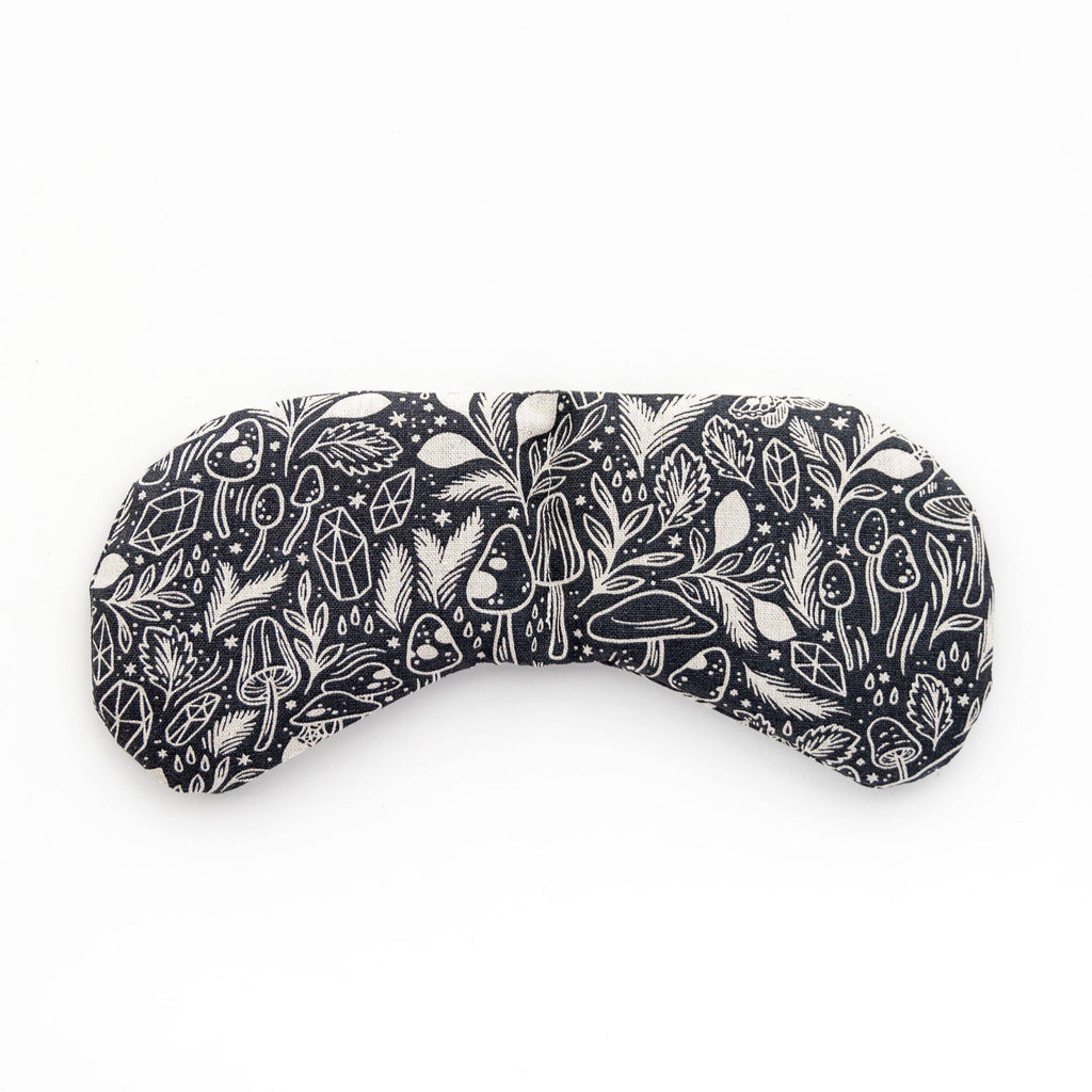 theraputic eye mask in black and white pattern with mushrooms, crystals, and stars