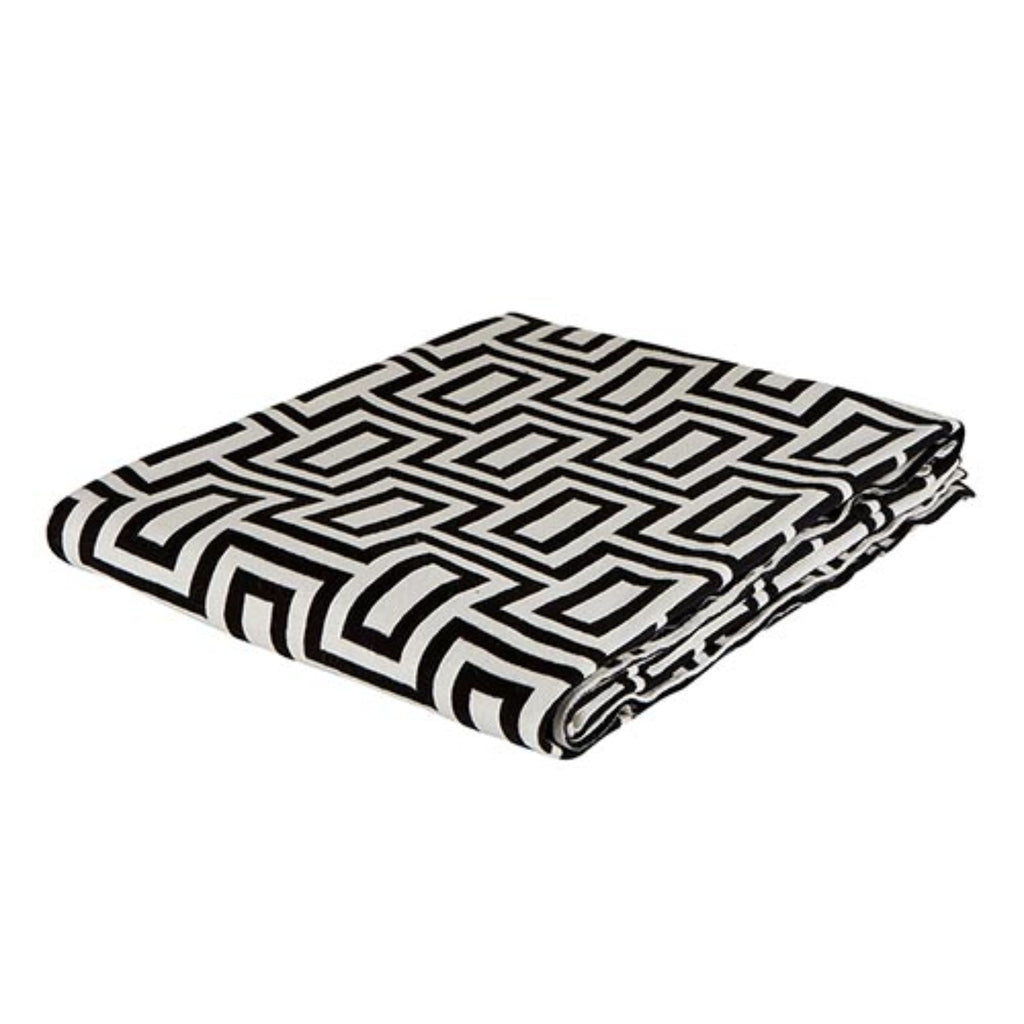 natural white and black rectangular geometric patterned knit throw, folded