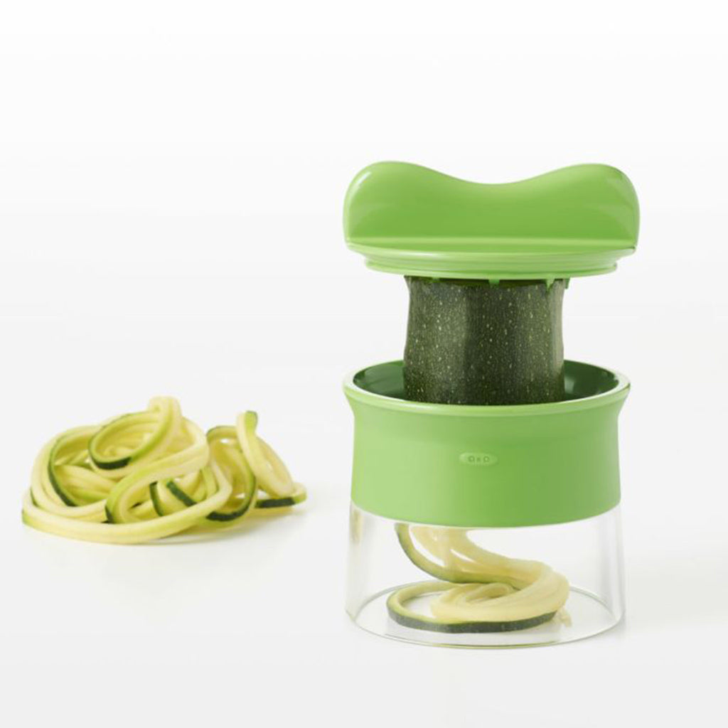 oxo good grips hand-held vegetable spiralizer kitchen tool with zucchini