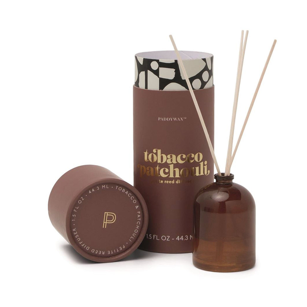 paddywax petite reed scented diffuser in tobacco patchouli with amber milky glass bottle and tube packaging