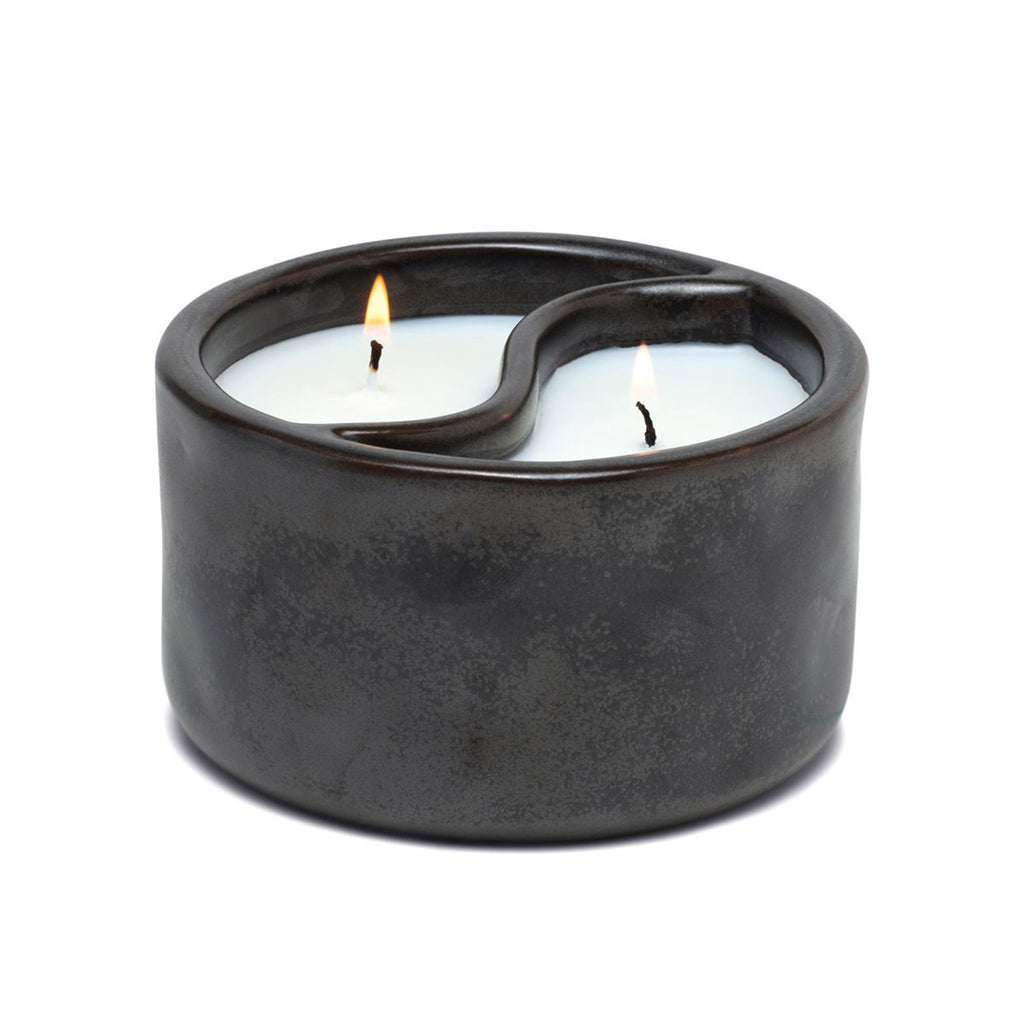 paddywax yin & yang 11 ounce palo santo and cade scented soy wax candle in ceramic vessel with black reactive matte glaze