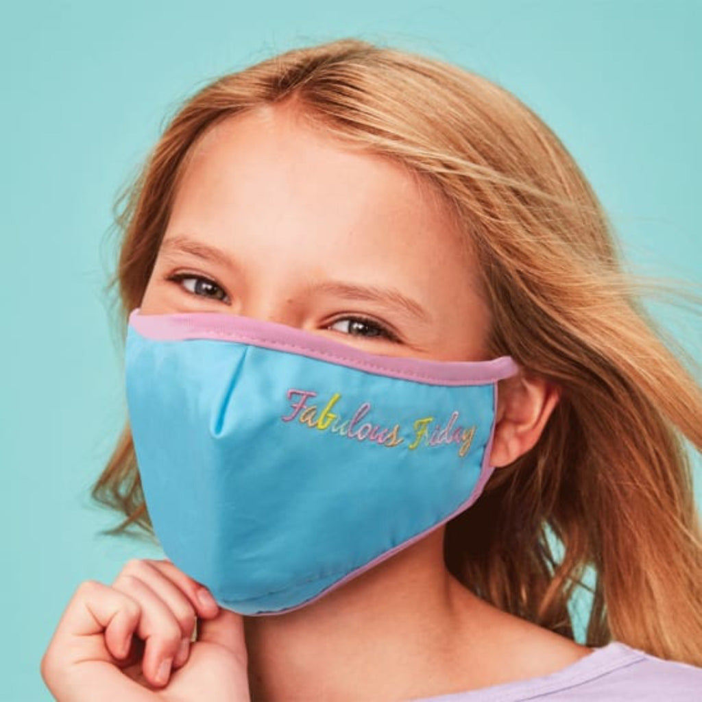 "child wearing blue mask with pink trim and the words ""fabulous friday"" embroidered in pastel rainbow colors"
