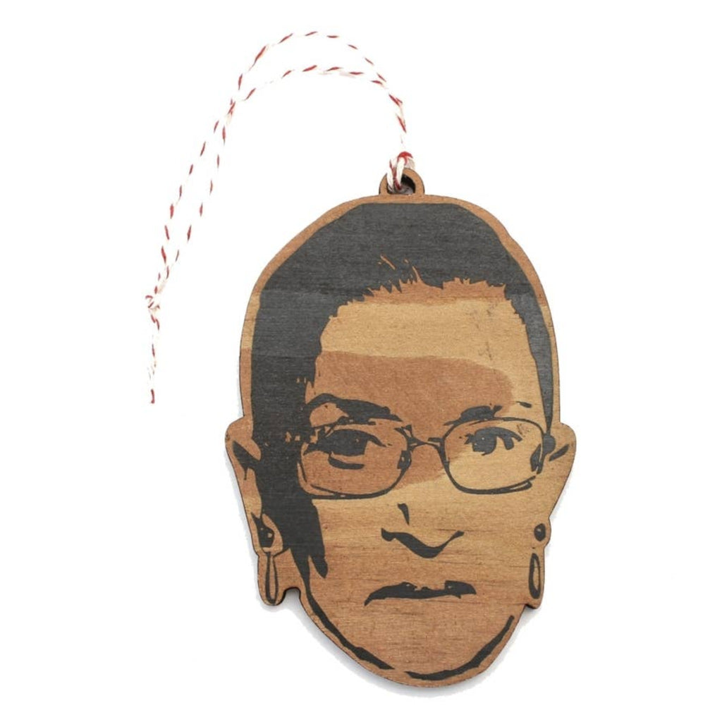 plywood ornament of ruth bader ginsburg's head