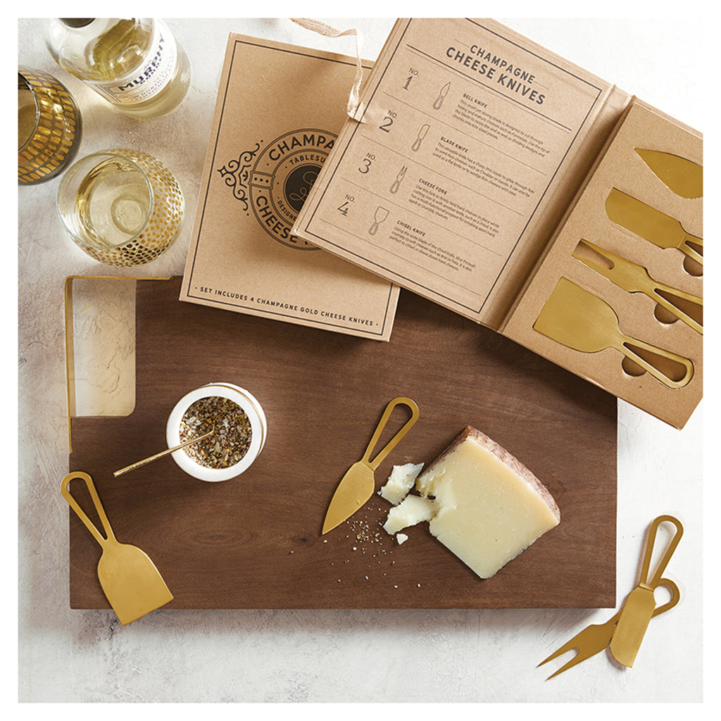 santa barbara design studio champagne gold stainless steel cheese knife set in entertaining setting