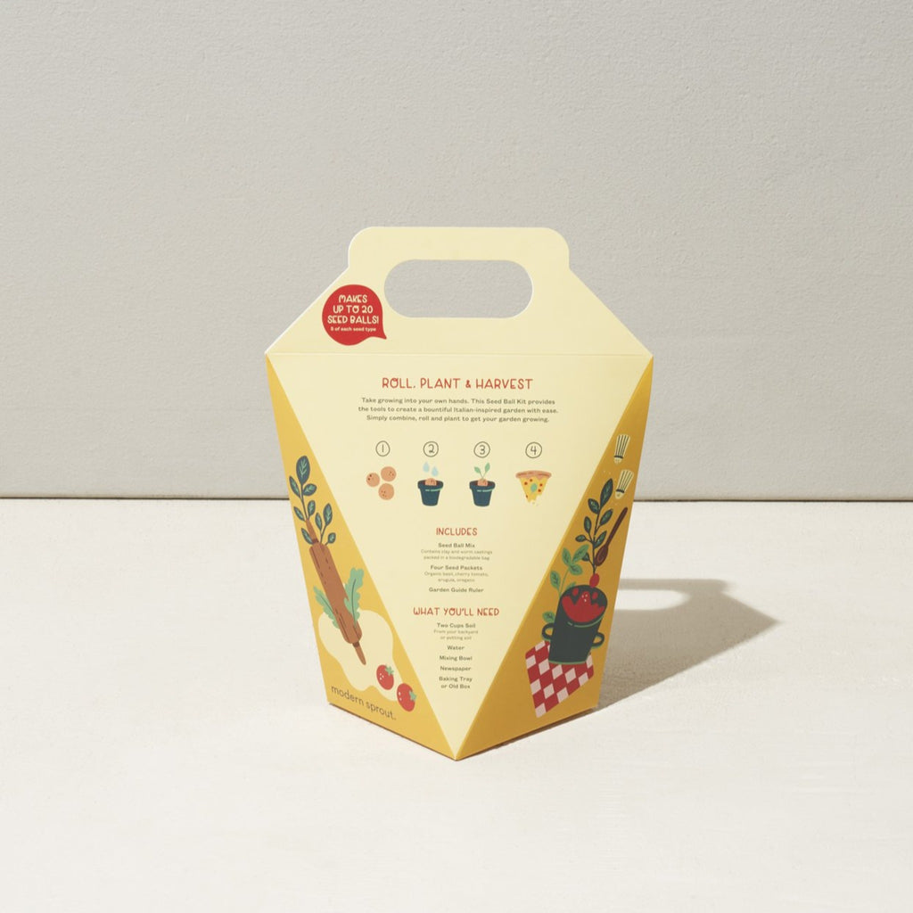 back of pizza garden seed ball kit in cream paper box with handle and illustrated with pizza slice in a garden
