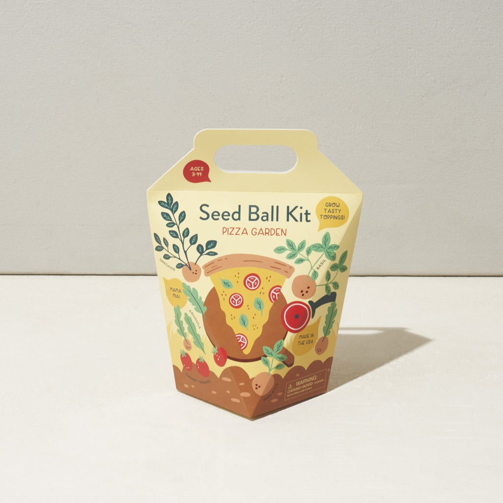 pizza garden seed ball kit in cream paper box with handle and illustrated with pizza slice in a garden