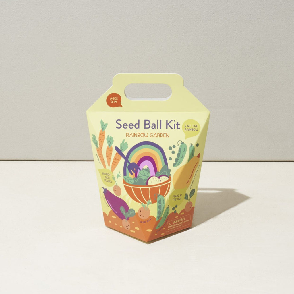 rainbow garden seed ball kit in yellow cardboard box with top handle and illustration of garden vegetables, and a salad bowl with a rainbow