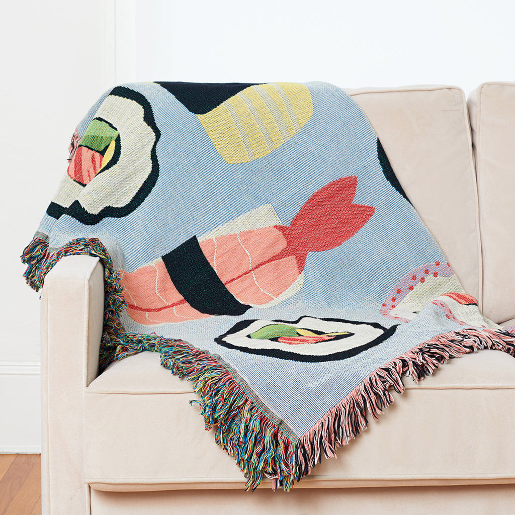 seltzer goods sushi roll throw blanket on sofa