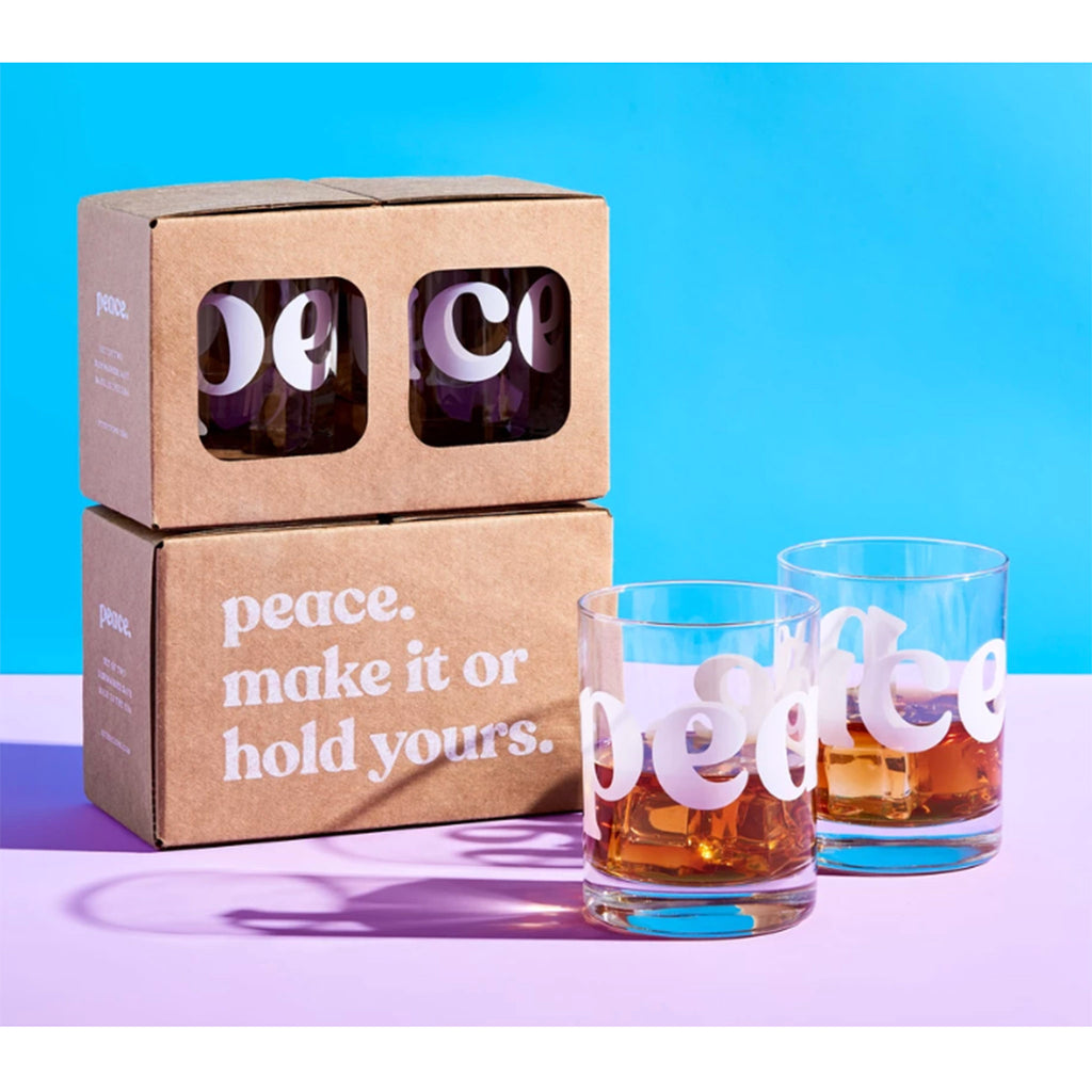 peace double old fashioned cocktail glasses with box on color background