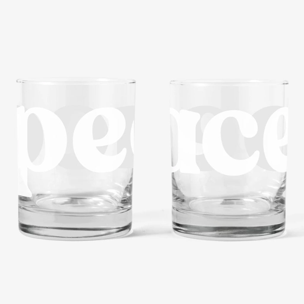 peace double old fashioned cocktail glasses white background