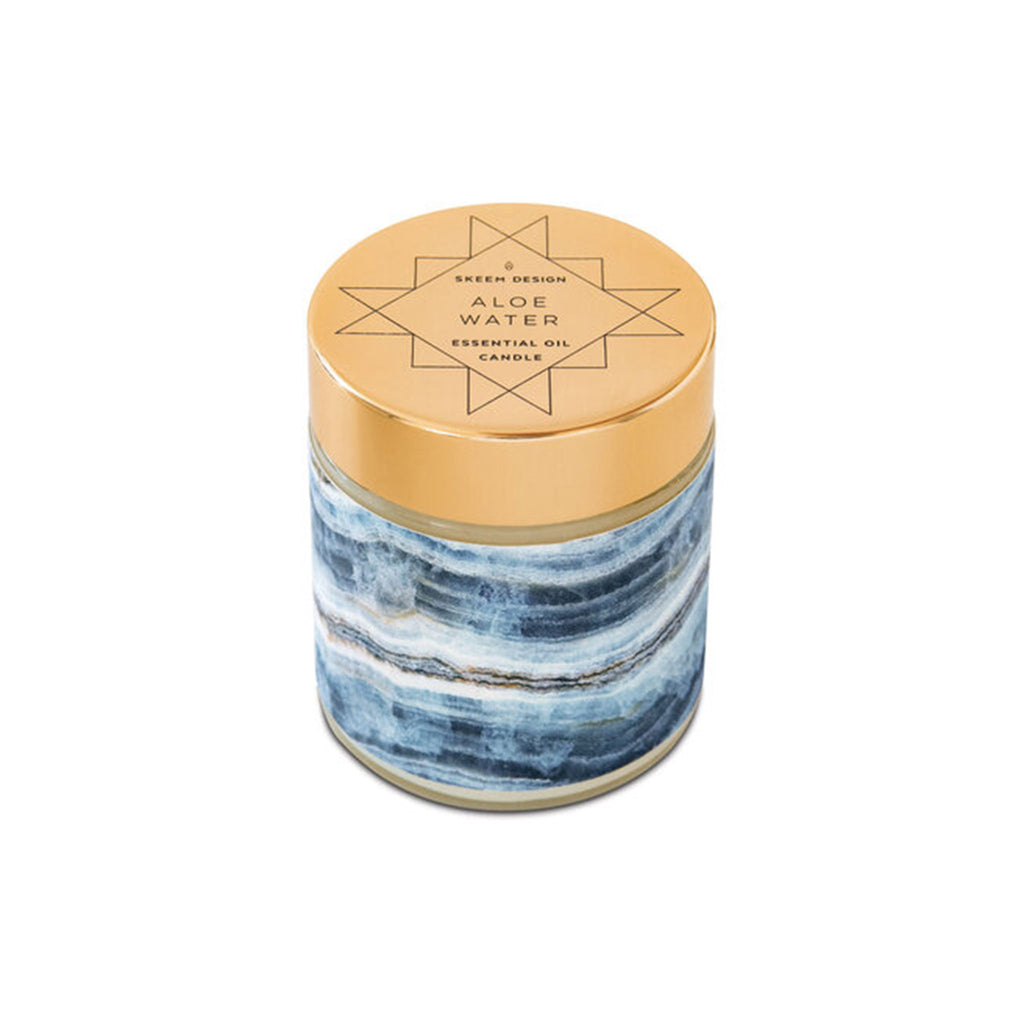 skeem sedona blue aloe water scented candle with lid on