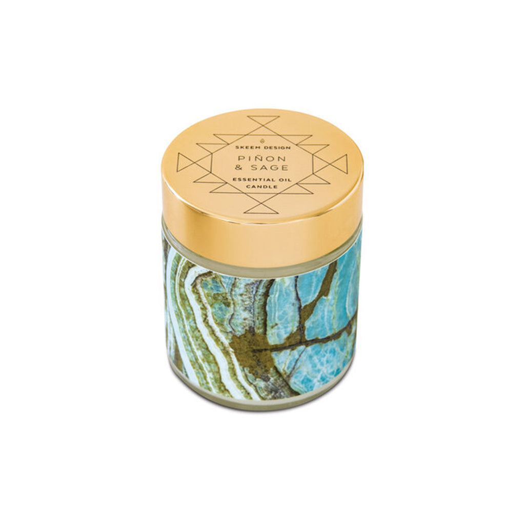 skeem sedona green piñon & sage scented candle with lid on