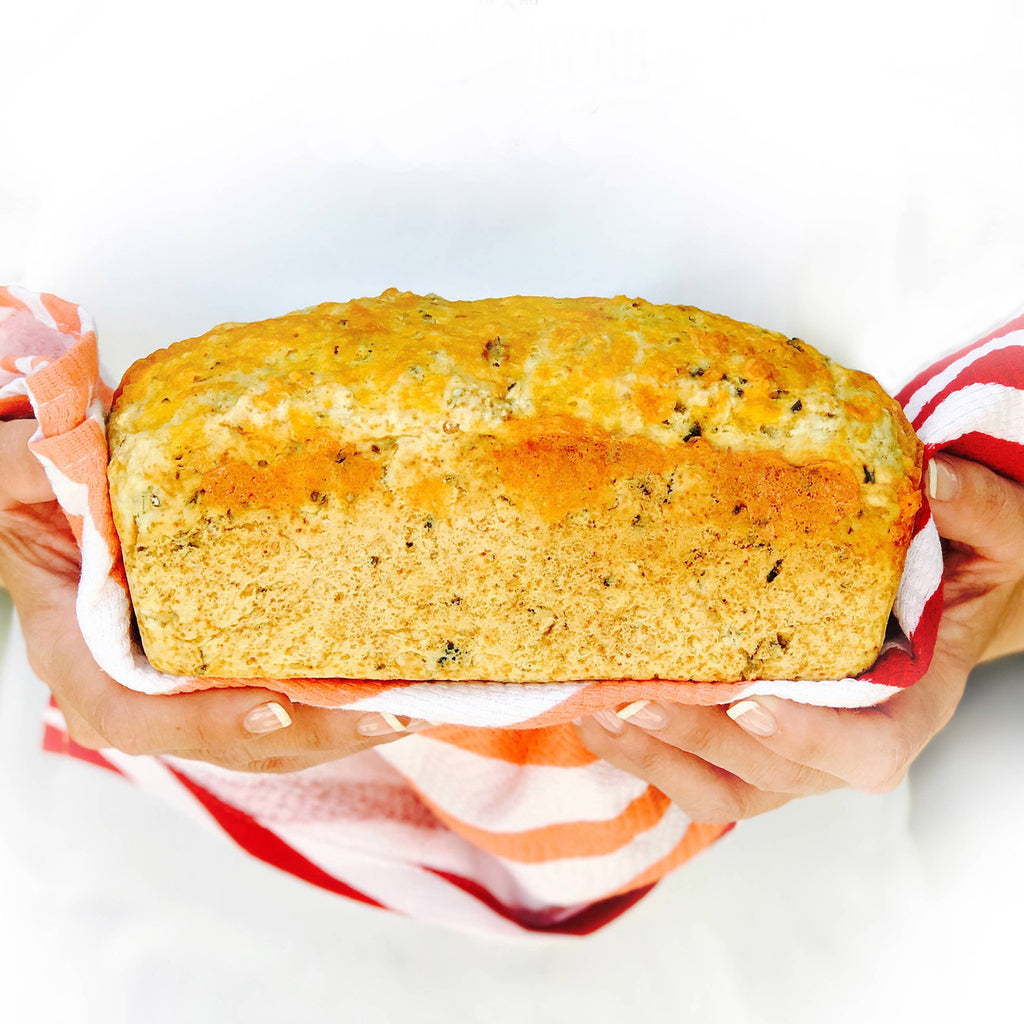soberdough cheesy garlic brew bread artisan beer bread mix baked loaf in hands