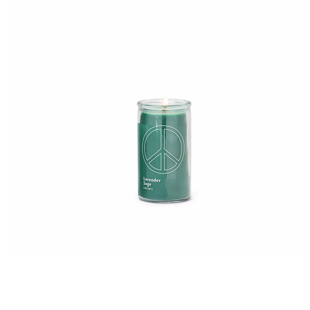 paddywax spark 5 ounce lavender sage scented prayer candle with forest green wax and a peace sign printed on clear glass in white