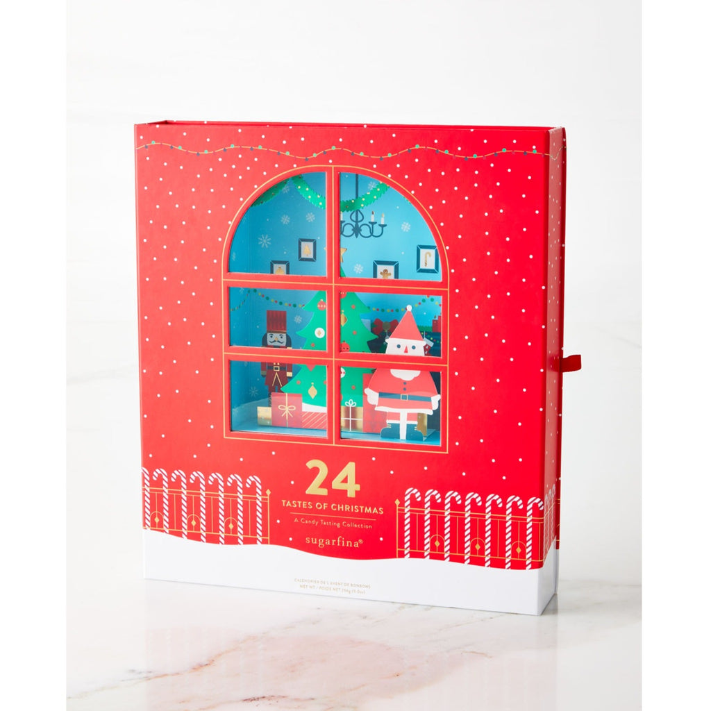 sugarfina candy advent calendar with window to a festive scene with santa, and christmas tree, and nutcracker
