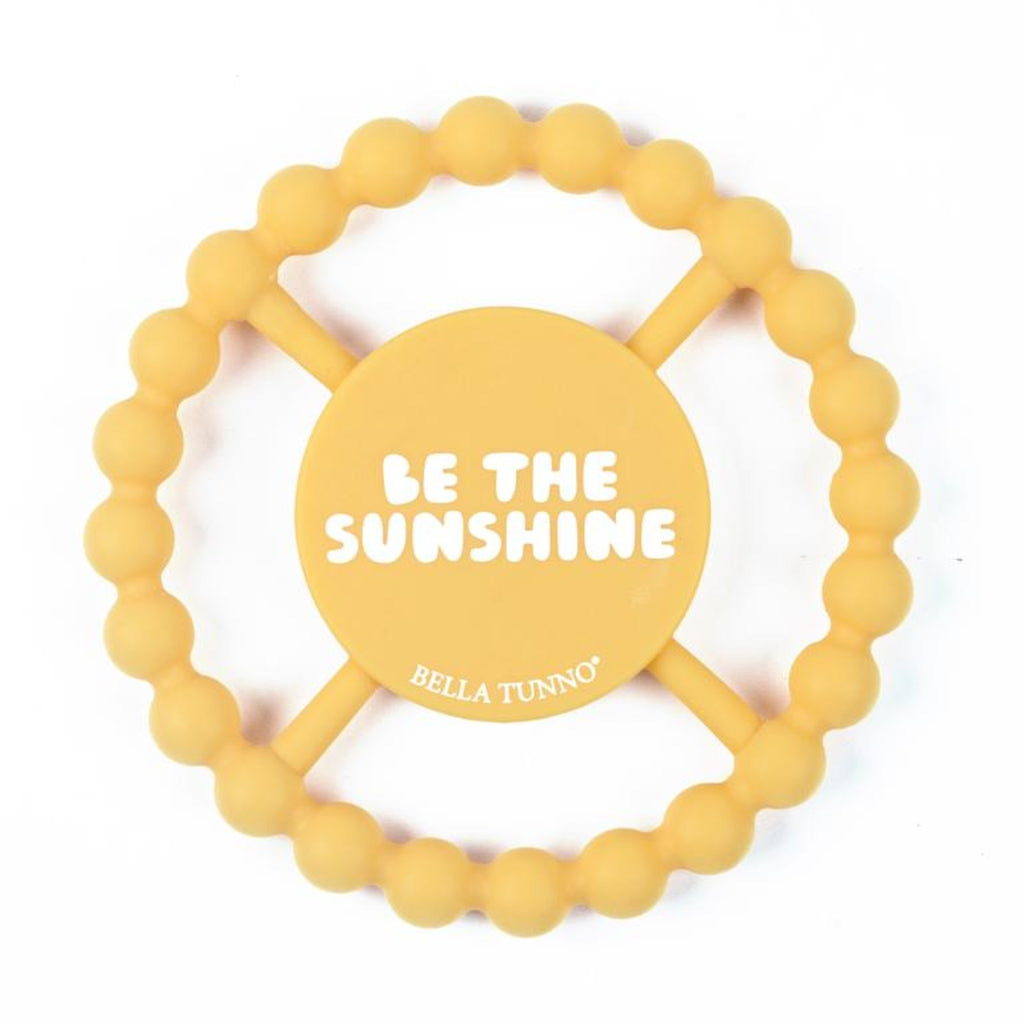 "yellow teething ring with the words ""be the sunshine"" in white"
