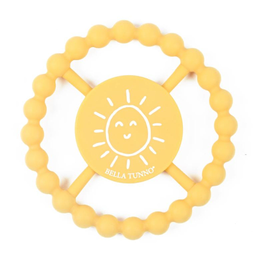 yellow teething ring with a white sun illustration