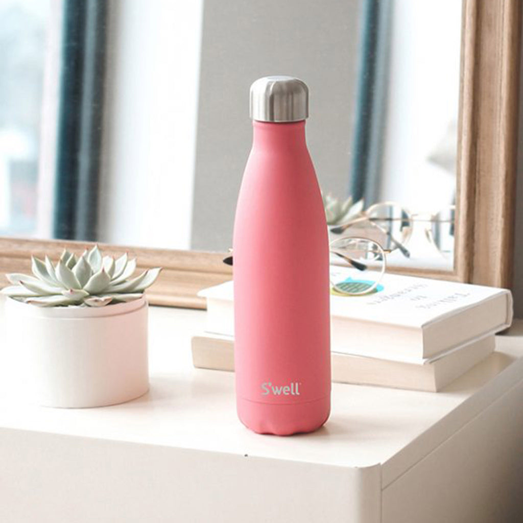 s'well coral reef 17 ounce insulated reusable stainless steel bottle in desk setting