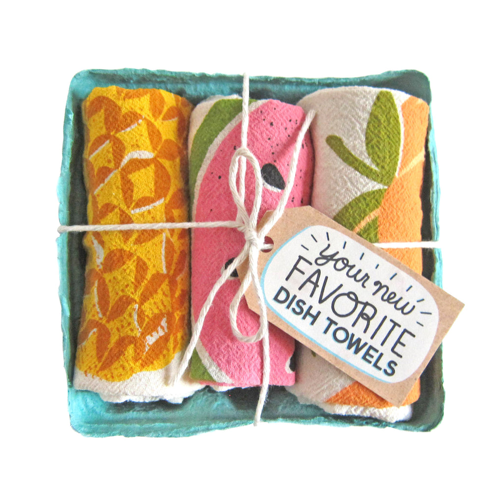 the neighborgoods shake your fruity set of three dish towels in packaging top view