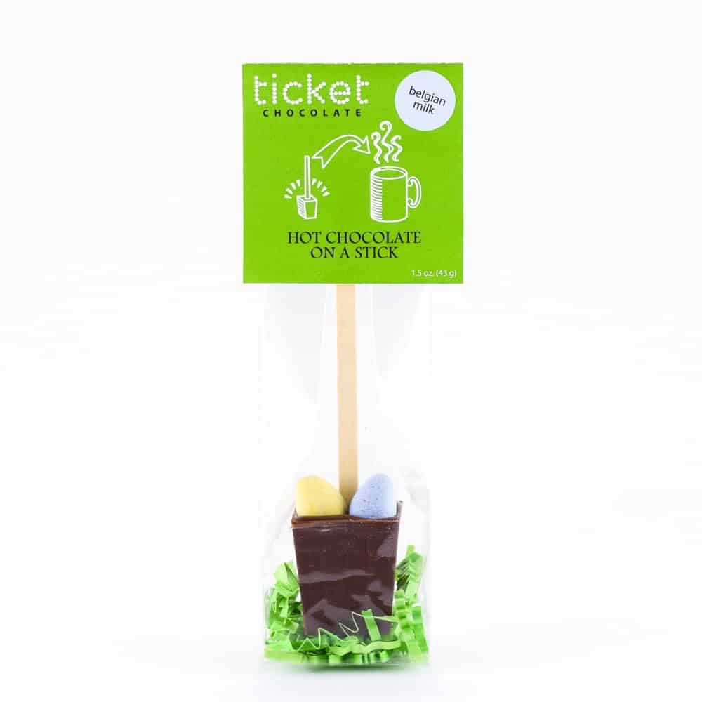 ticket chocolate belgian milk hot chocolate on a stick easter with spring eggs and grass