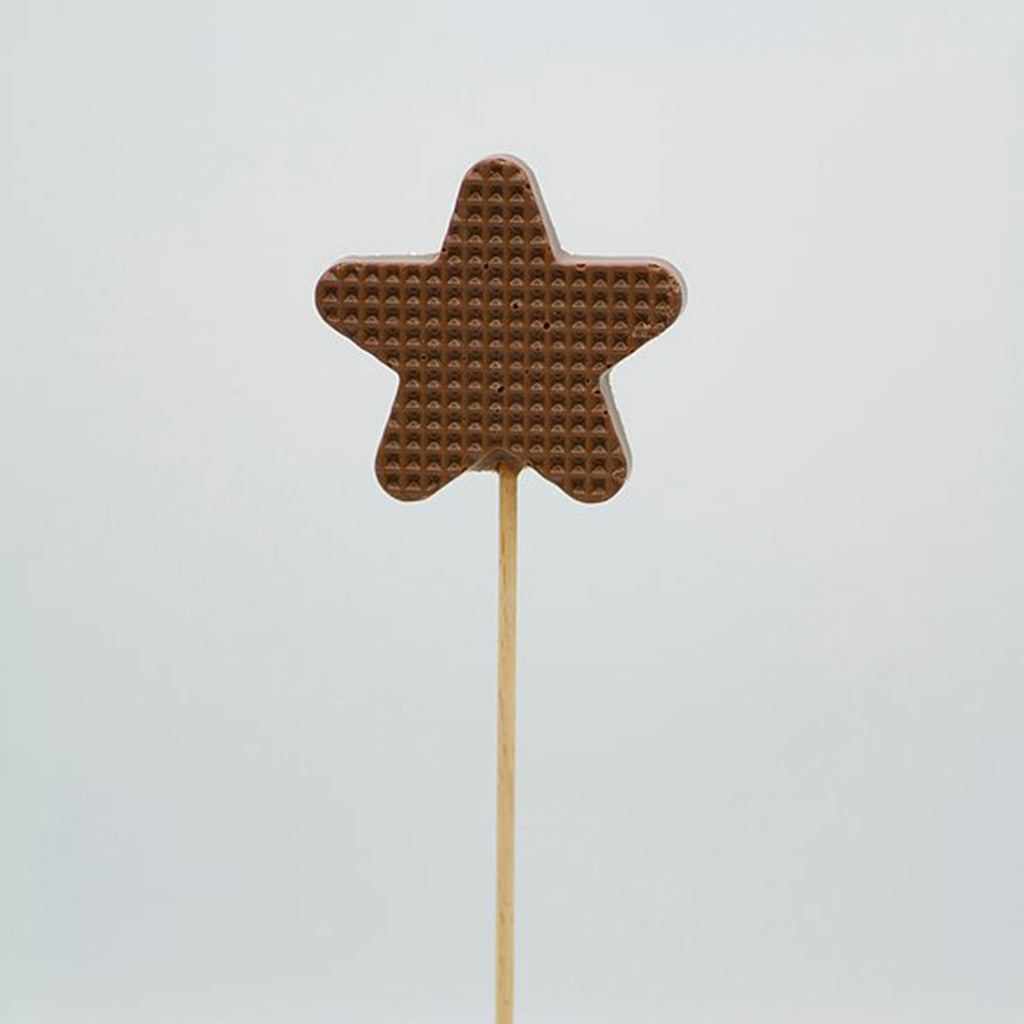 tri-connect belgian milk chocolate star lollipop with gold non-pareils back