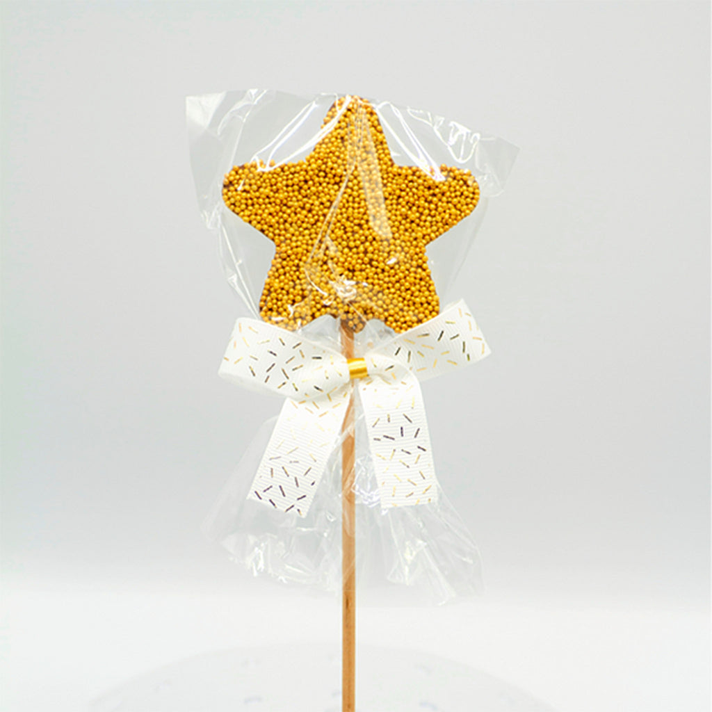 tri-connect belgian milk chocolate star lollipop with gold non-pareils front