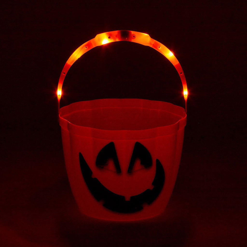 two's company jack-o-lantern trick or treat candy bucket with light up handle on black background lit