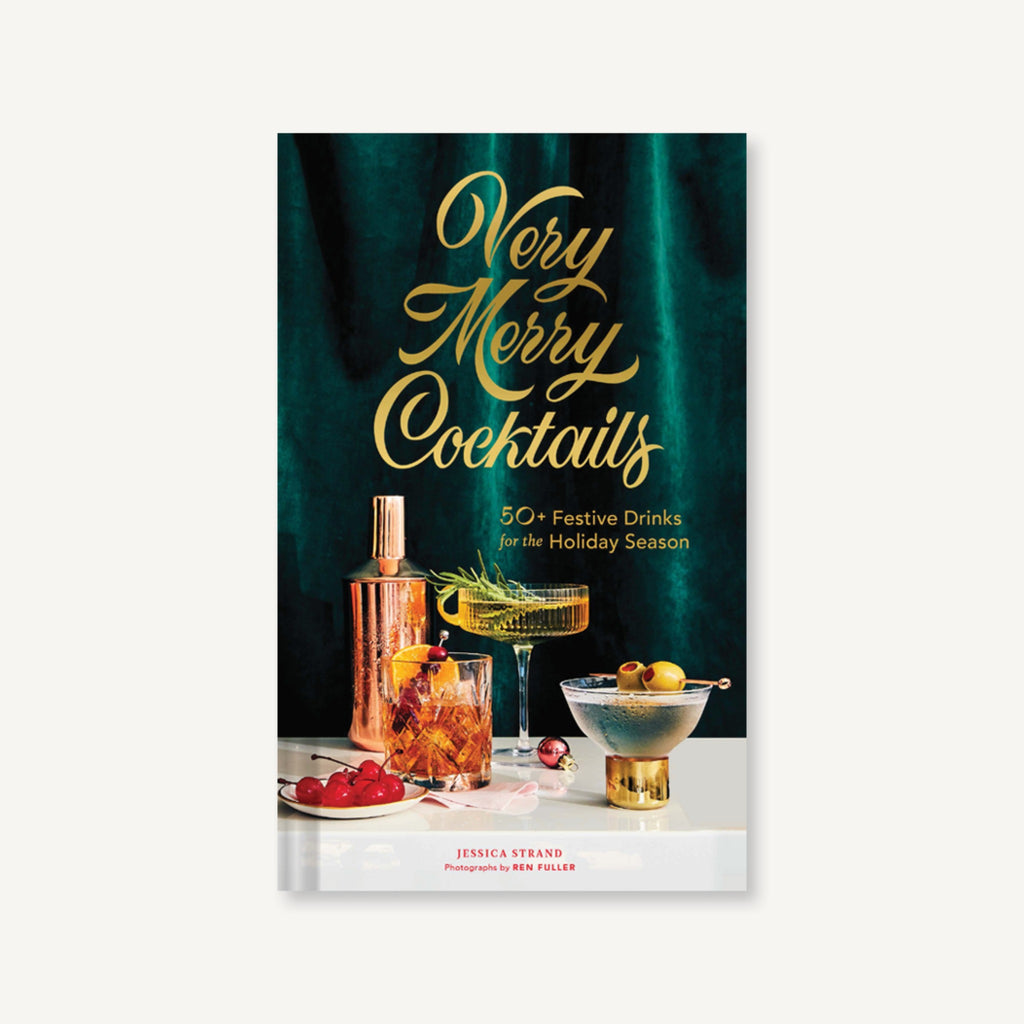 "book cover with photograph of a cocktails shaker and cocktails with green velvet background and the words ""very merry cocktails"" in gold script"
