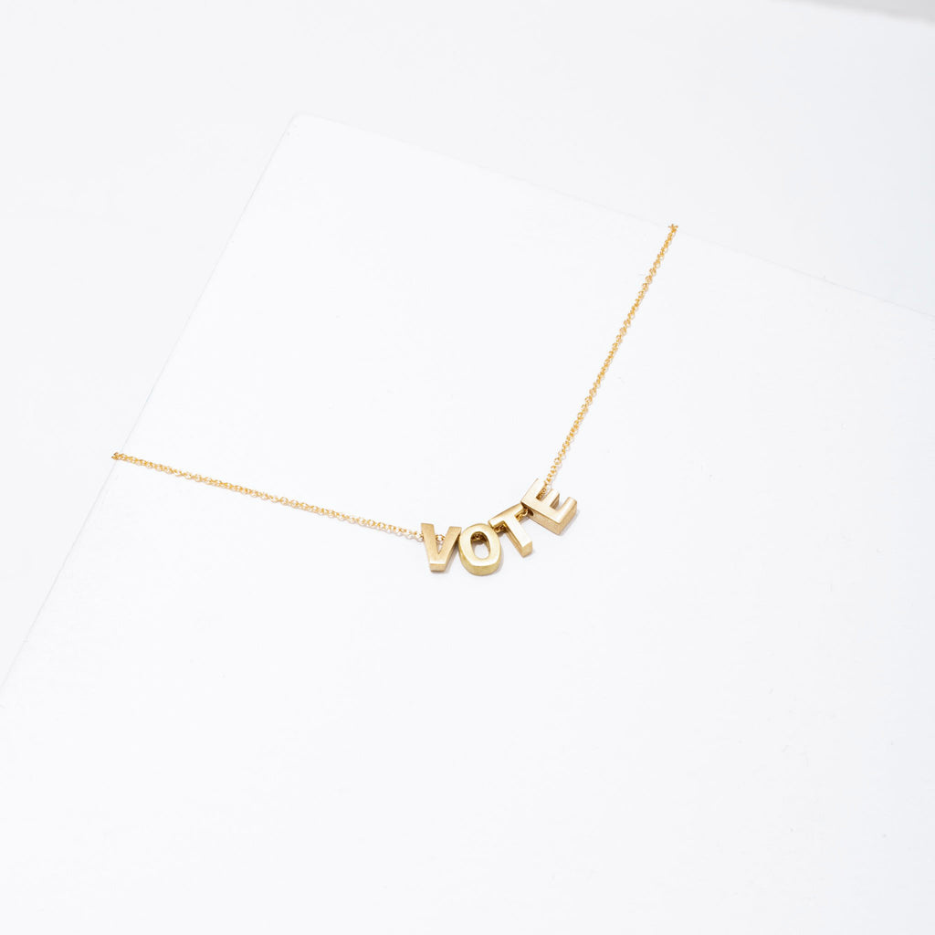 larissa loden gold plated vote necklace