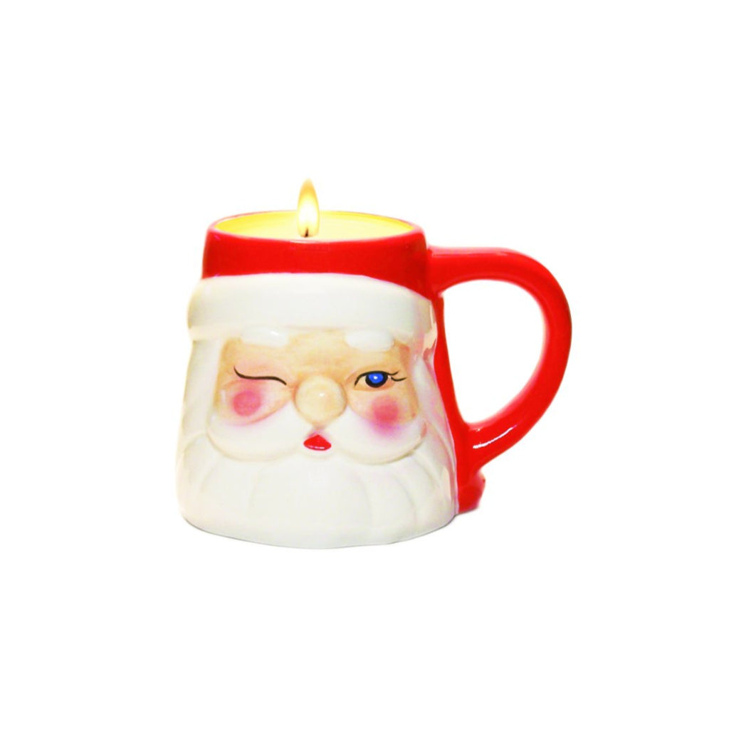 candle in a mini mug shaped like a winking santa head