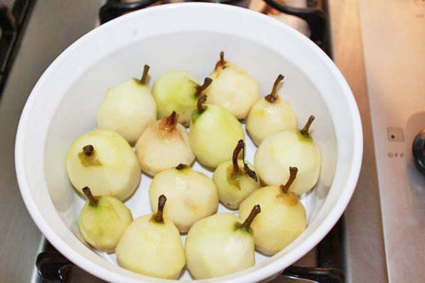 Peeled Seckel Pears in a Baking Dish