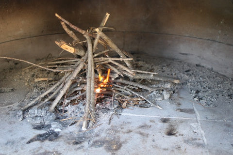 Starting a fire in a wood-fired oven