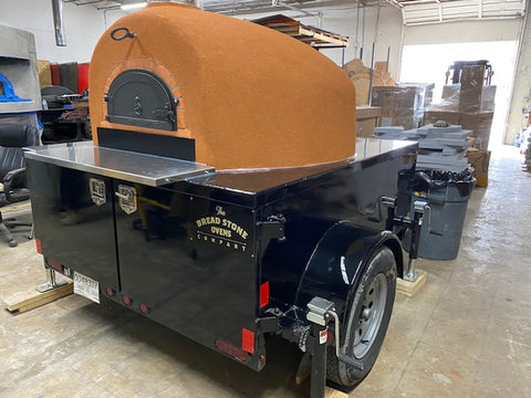 Starter Pro Wood Fired Pizza Oven Trailer Black with Red Rock Stucco