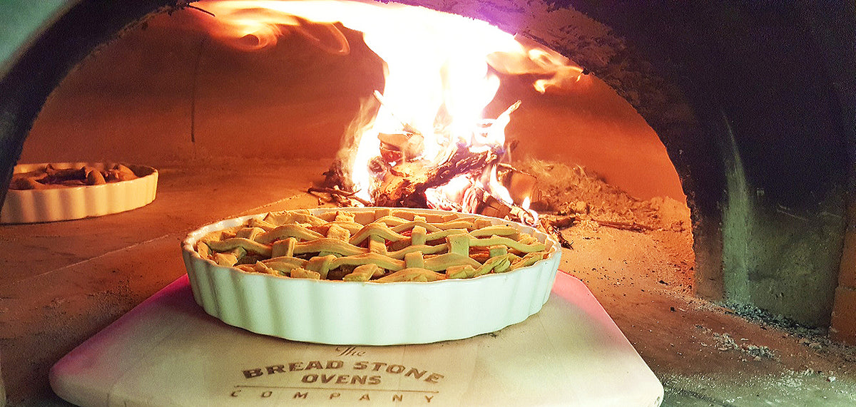 lattice top apple pied baking in a wood fired oven