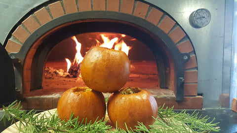baked mini pumpkins in front of fire