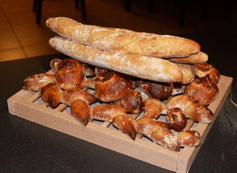 Traditional French Baguettes baked in a wood-fired brick oven