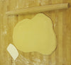 brioche dough rolled out with rolling pin