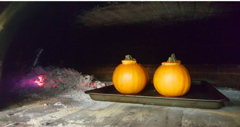 mini pumpkins in a wood fired oven