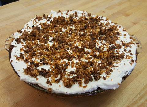 pumpkin pie with maple whipped cream and cinnamon crunch topping