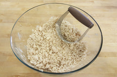 butter oats and flour blended together in a mixing bowl