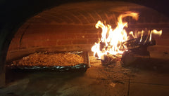 granola baking in a wood fired oven