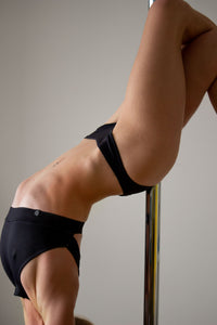 Low waist black micro shorts for pole dance with a cheeky brazil scrunch back