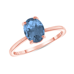 Oval Solitaire Genuine Blue Topaz Gemstone Birthstone Ring in Rose Gold
