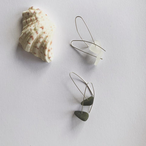 Clear hues and greens, beach glass  Sterling silver hair pin ear hooks The simple love The simple shapes A touch of nature, a touch of elegant Naturally ocean tumbled with the sands and the salts of the ocean.........  Beach glass on sterling silver hair pin ear hooks