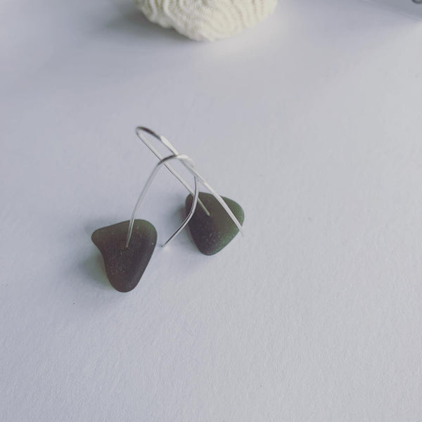 Beach Glass Earrings. Clear hues and greens, beach glass  Sterling silver hair pin ear hooks The simple love The simple shapes A touch of nature, a touch of elegant Naturally ocean tumbled with the sands and the salts of the ocean.........  Beach glass on sterling silver hair pin ear hooks
